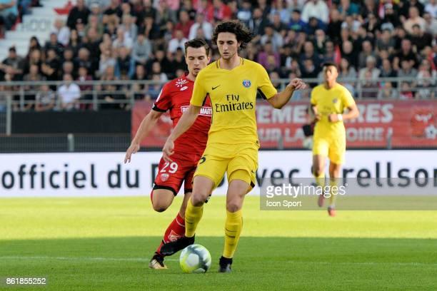 Benjamin Jeanot of Dijon and Adrien Rabiot of PSG during the Ligue 1 match between Dijon FCO and Paris Saint Germain at Stade Gaston Gerard on...