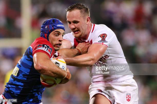 Benjamin Jullien of France fends off Ben Currie of England during the 2017 Rugby League World Cup match between England and France at nib Stadium on...
