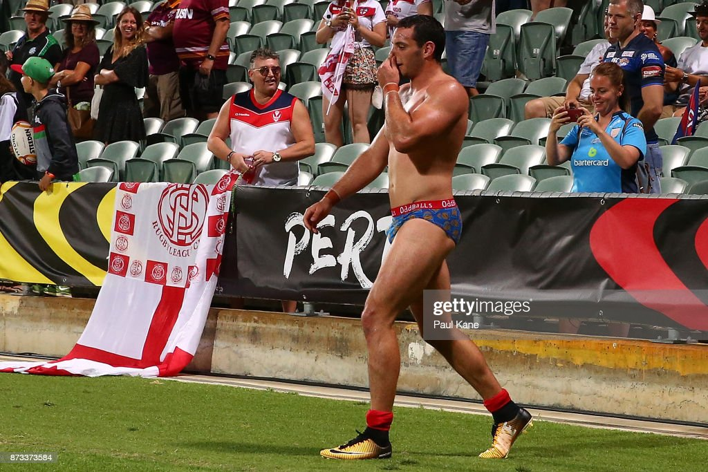 Benjamin Jullien of France walks across the pitch after handing his shorts to a supectator after being defaeted during the 2017 Rugby League World Cup match between England and France at nib Stadium on November 12, 2017 in Perth, Australia.