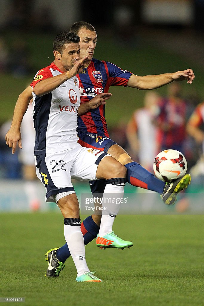 Benjamin Kantarovski of the Jets contests the ball with Fabio Ferreira of Adelaide during the round 27 A-League match between the Newcastle Jets and Adelaide United at Hunter Stadium on April 11, 2014 in Newcastle, Australia.