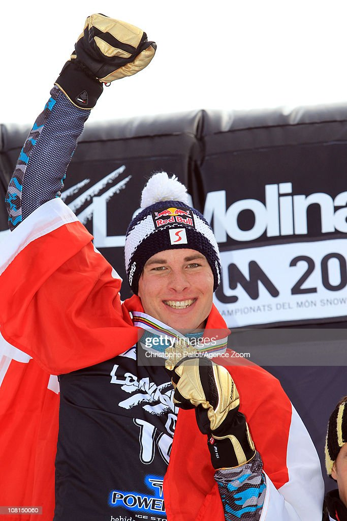<a gi-track='captionPersonalityLinkClicked' href=/galleries/search?phrase=Benjamin+Karl&family=editorial&specificpeople=4586461 ng-click='$event.stopPropagation()'>Benjamin Karl</a> of Austria takes 1st place during the FIS Snowboard World Championships Men's and Women's Parallel Giant Slalom on January 19, 2011 in La Molina, Spain.