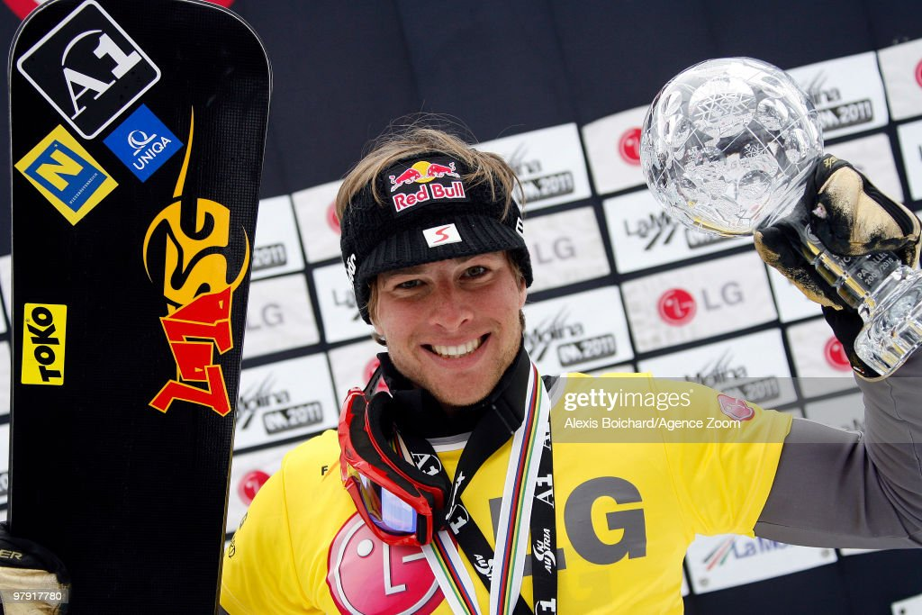 <a gi-track='captionPersonalityLinkClicked' href=/galleries/search?phrase=Benjamin+Karl&family=editorial&specificpeople=4586461 ng-click='$event.stopPropagation()'>Benjamin Karl</a> of Austria takes the globe for the overall World Cup during the LG Snowboard FIS World Cup Men's Parallel Giant Slalom on March 21, 2010 in La Molina, Spain.