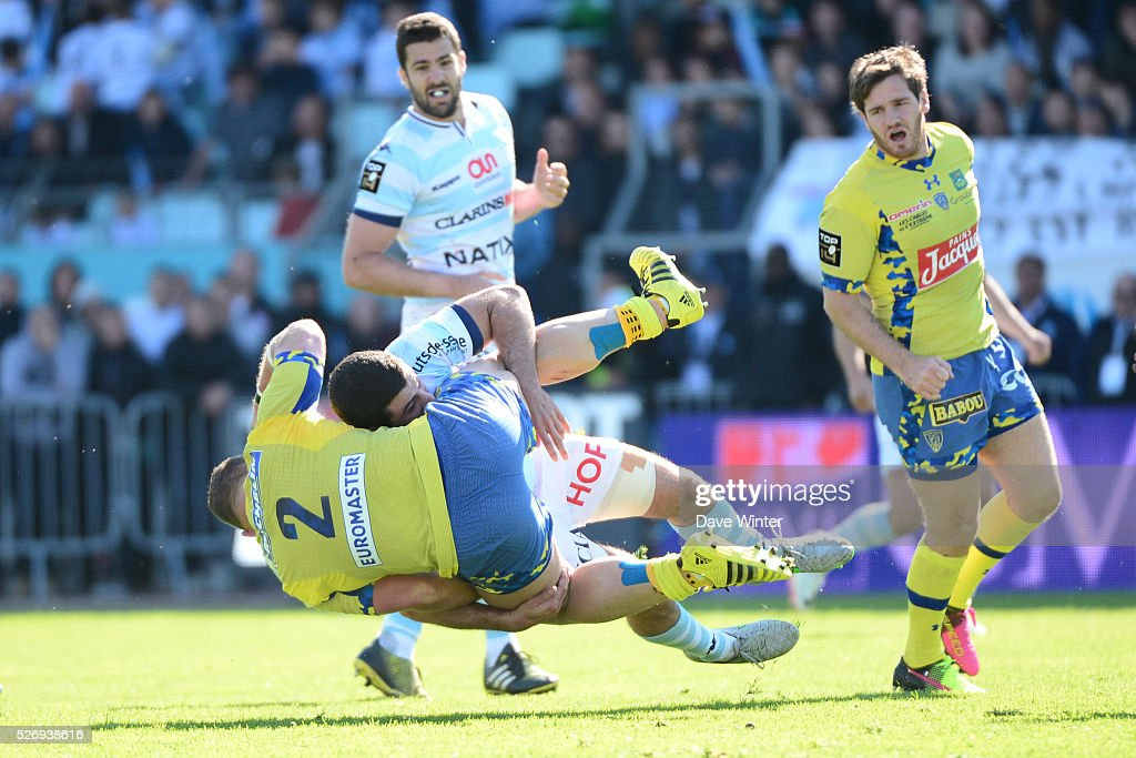 Benjamin Kayser of Clermont is tackled by Remi Tales of Racing 92 during the French Top 14 rugby union match between Racing 92 v Clermont at Stade Yves Du Manoir on May 1, 2016 in Colombes, France.