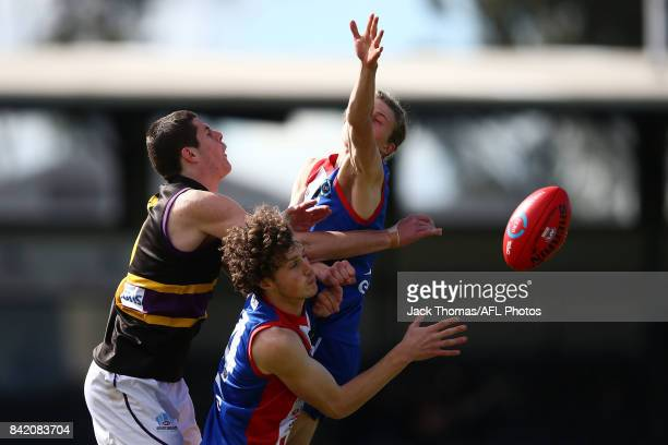 Benjamin Kelly of the Murray Bushrangers competes for the ball against Xavier Duursma and Sean Masterson of the Power during the TAC Cup round 18...