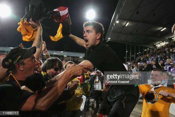 Benjamin Kirsten of Dresden celebrates the rise to the Second Bundesliga after winning 31 after extra time the Second Bundesliga playoff second leg...