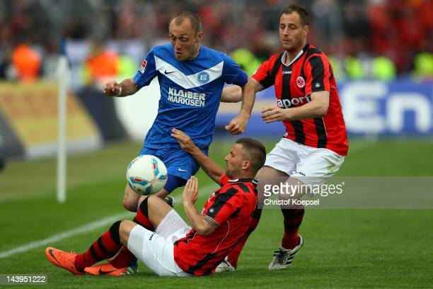 Benjamin Koehler and Matthias Lehmann of Frankfurt challenge Alexander Iashvili of Karlsruhe during the Second Bundesliga match between Karlsruher SC...