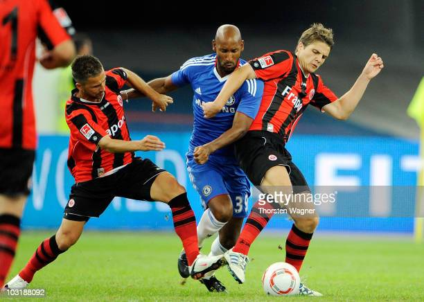 Benjamin Koehler and Pirmin Schwegler of Frankfurt battle for the ball with Nicolas Anelka of Chelsea during the international preseason friendly...