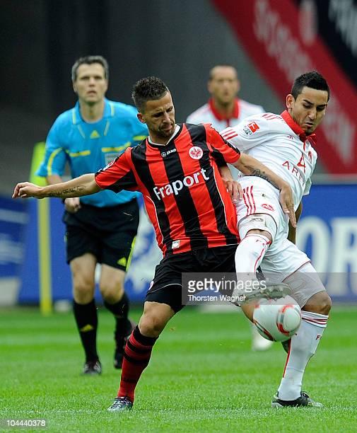 Benjamin Koehler of Frankfurt battles for the ball with Ilkay Guendogan of Nuernberg during the Bundesliga match between Eintracht Frankfurt and 1FC...