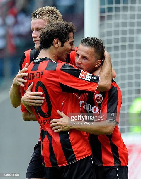 Benjamin Koehler of Frankfurt celebrates after scoring the first goal with his team mates Maik Franz and Halil Altintop during the Bundesliga match...