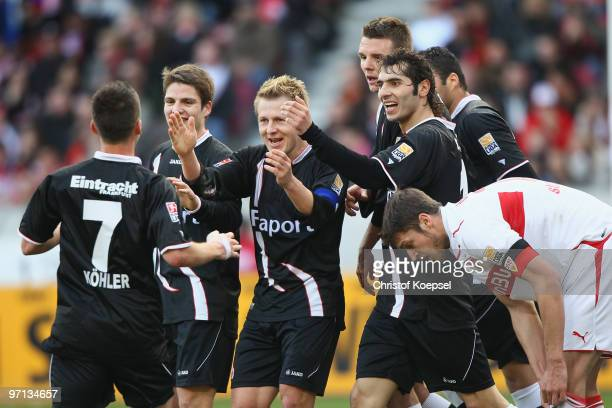 Benjamin Koehler of Frankfurt celebrates the first goal with his team and Matthieu Delpierre of Stuttgart looks dejected during the Bundesliga match...