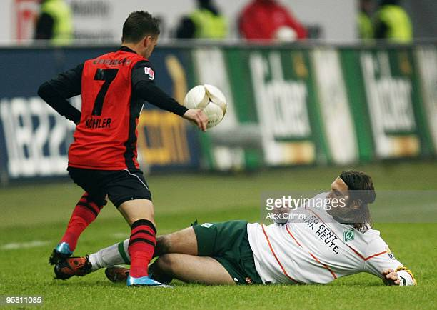 Benjamin Koehler of Frankfurt is challenged by Torsten Frings of Bremen during the Bundesliga match between Eintracht Frankfurt and Werder Bremen at...