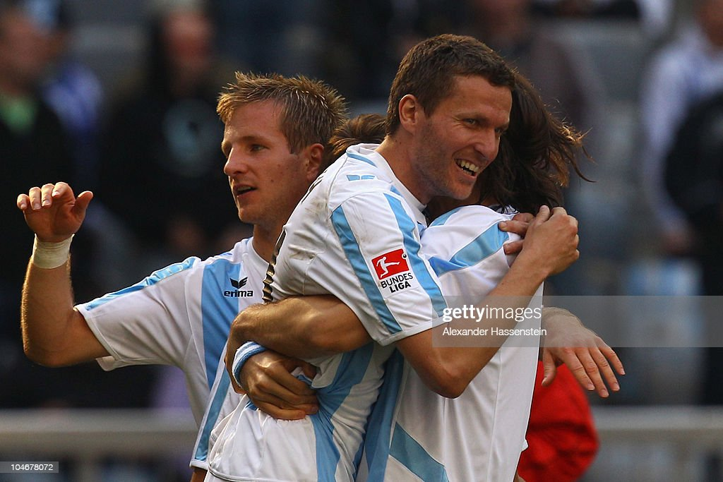 Benjamin Lauth (C) of Muenchen celebrates victory with his team mates Djordje Rakic (R) and <a gi-track='captionPersonalityLinkClicked' href=/galleries/search?phrase=Stefan+Aigner&family=editorial&specificpeople=764034 ng-click='$event.stopPropagation()'>Stefan Aigner</a> (L) after the Second Bundesliga match between TSV 1860 Muenchen and Union Berlin at the Allianz Arena on October 3, 2010 in Munich, Germany.