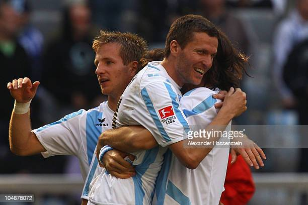 Benjamin Lauth of Muenchen celebrates victory with his team mates Djordje Rakic and Stefan Aigner after the Second Bundesliga match between TSV 1860...