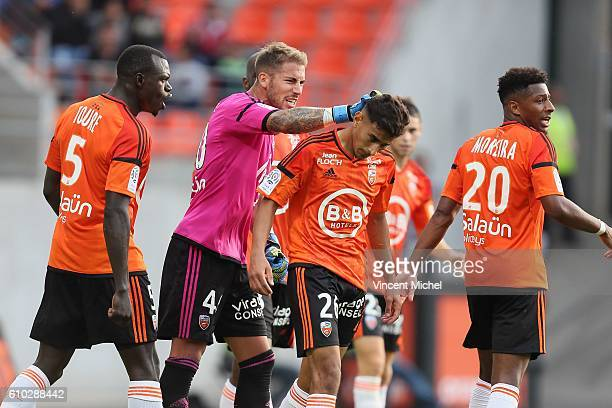 Benjamin Lecomte of Lorient and Issam Ben Khemiss of Lorient during the Ligue 1 match between FC Lorient and Olympique Lyonnais at Stade du Moustoir...