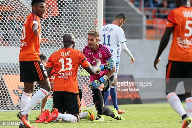 Benjamin Lecomte of Lorient and Michael Ciani of Lorient during the Ligue 1 match between FC Lorient and Olympique Lyonnais at Stade du Moustoir on...