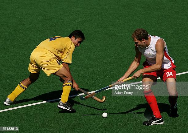 Benjamin Marsden of England tackles Kali Logan Raj of Malaysia in the Men's Bronze Medal match between England and Malaysia during the hockey at the...