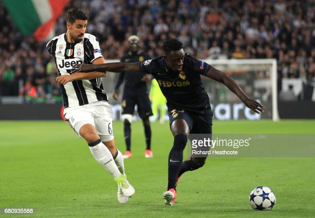 Benjamin Mendy of AS Monaco holds off Sami Khedira of Juventus during the UEFA Champions League Semi Final second leg match between Juventus and AS...