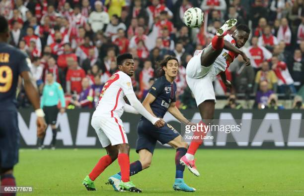 Benjamin Mendy of AS Monaco jump over Edinson Cavani of Paris SaintGermain during the French League Cup Final match between Paris SaintGermain and AS...