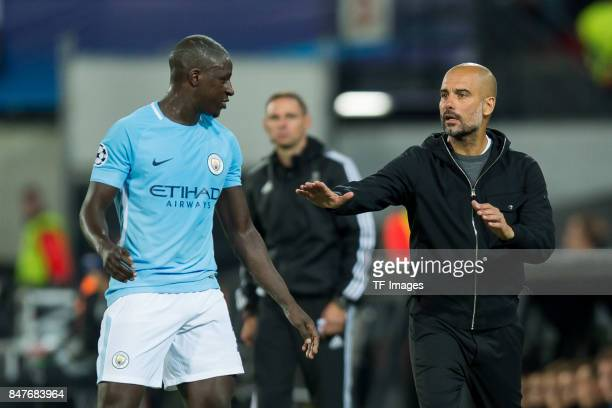 Benjamin Mendy of Manchester City and Head coach Pep Guardiola of Manchester City looks on during the UEFA Champions League match between Feyenoord...