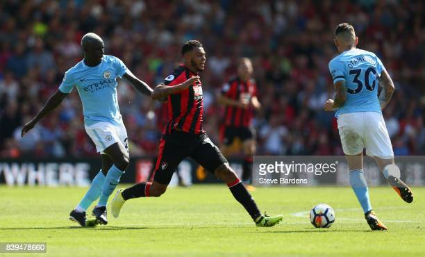 Benjamin Mendy of Manchester City and Joshua King of AFC Bournemouth battle for possession during the Premier League match between AFC Bournemouth...