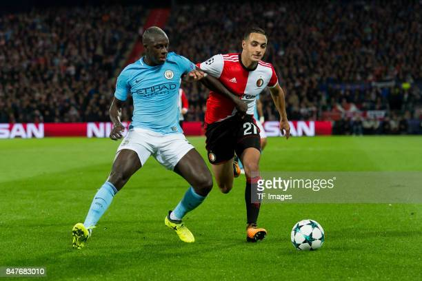 Benjamin Mendy of Manchester City and Sofyan Amrabat of Rotterdam battle for the ball during the UEFA Champions League match between Feyenoord...