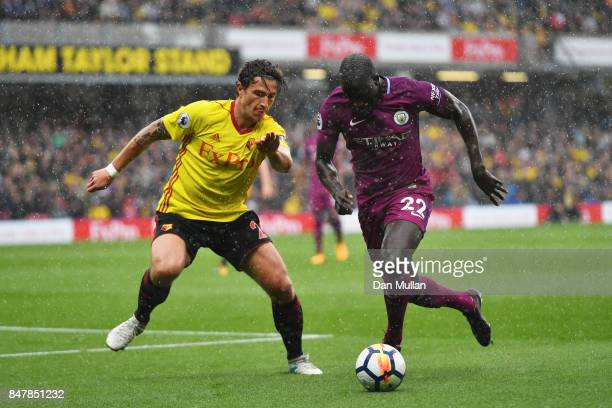 Benjamin Mendy of Manchester City attempts to get past Daryl Janmaat of Watford during the Premier League match between Watford and Manchester City...