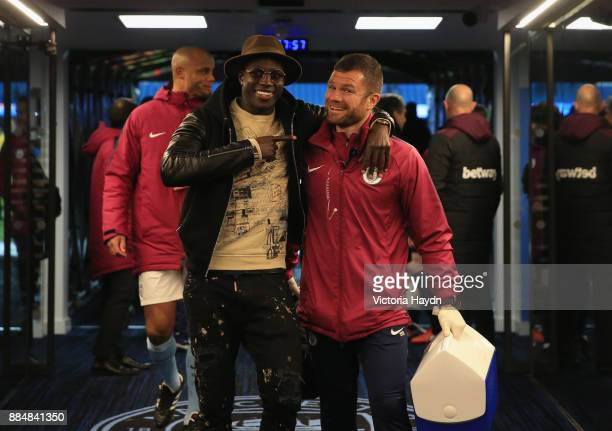 Benjamin Mendy of Manchester City celebrates with a staff member after the Premier League match between Manchester City and West Ham United at Etihad...