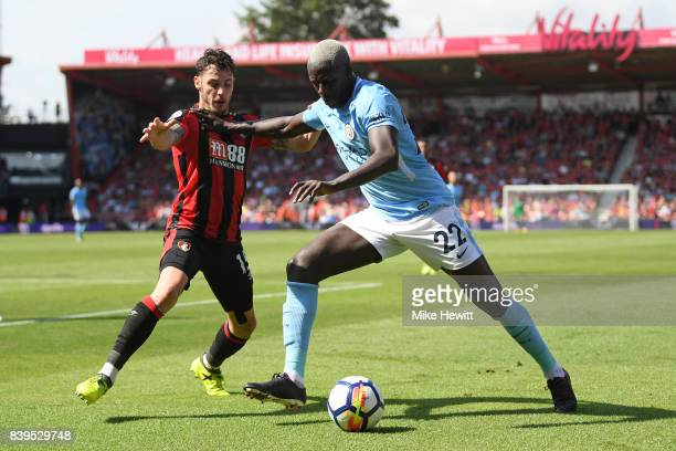 Benjamin Mendy of Manchester City holds off Adam Smith of Bournemouth during the Premier League match between AFC Bournemouth and Manchester City at...