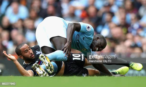 Benjamin Mendy of Manchester City is challenged by Andros Townsend of Crystal Palace during the Premier League match between Manchester City and...