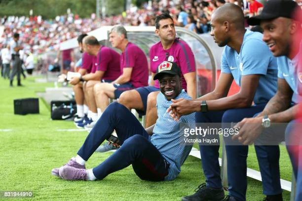 Benjamin Mendy of Manchester City sits on the side line during the preseason friendly match between Girona and Manchester City at Municipal de...