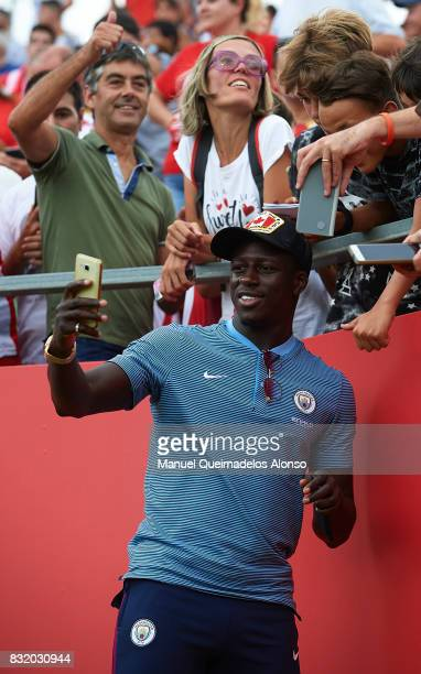 Benjamin Mendy of Manchester City takes a selfie photograph with fans during the preseason friendly match between Girona and Manchester City at...