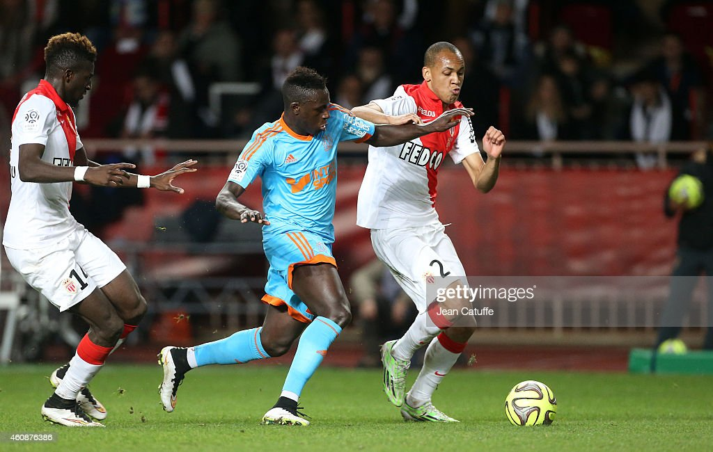 <a gi-track='captionPersonalityLinkClicked' href=/galleries/search?phrase=Benjamin+Mendy&family=editorial&specificpeople=7029850 ng-click='$event.stopPropagation()'>Benjamin Mendy</a> of OM and Fabio Tavares of Monaco in action during the French Ligue 1 match between AS Monaco FC v Olympique de Marseille OM at Stade Louis II on December 14, 2014 in Monaco.