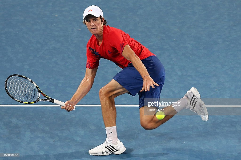 Benjamin Mitchell of Australia plays a forehand in his match against Marcos Baghdatis of Cyprus during day two of the Brisbane International at Pat Rafter Arena on December 31, 2012 in Brisbane, Australia.