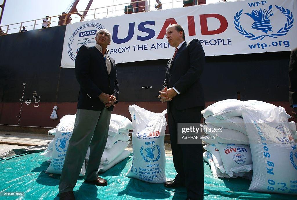 Benjamin Moeling (R), the charge d'affaires of the US embassy in Khartou, stands with WFP Sudan chief Adnan Khan as a US aid shipment organised by the US Agency for International Development and the World Food Programme arrives at Port Sudan on the Red Sea coast, on May 5, 2016. Dockers began unloading tens of thousands of tonnes of food from a US aid ship destined for war-torn areas of Sudan, an AFP correspondent reported. The bulk carrier Liberty Grace docked in Port Sudan with a cargo of 47,500 tonnes of sorghum, a staple food in Sudan. SHAZLY