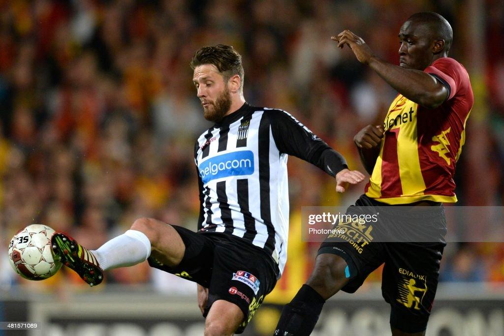 Benjamin Mokulu of KV Mechelen battles for the ball with Damien Marcq of Charleroi during the Jupiler Pro League play off 2 match between KV Mechelen and Royal Charleroi Sporting Club on March 30, 2014 in Mechelen, Belgium.
