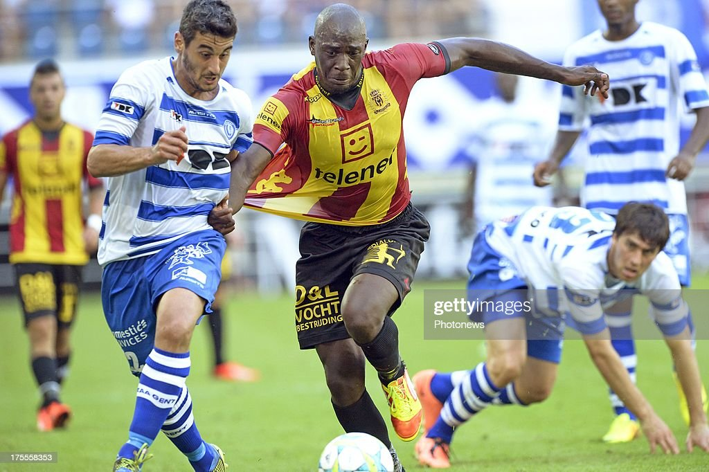 Benjamin Mokulu of KV Mechelen battles for the ball with Pablo Cendros Lopez of KAA Gent and Ervin Zukanovic of KAA Gent during the Jupiler League match between KAA Gent and KV Mechelen on August 04, 2013 in the Ghelamco stadium Gent, Belgium. (Photo by Nico Vereecken / Photonews