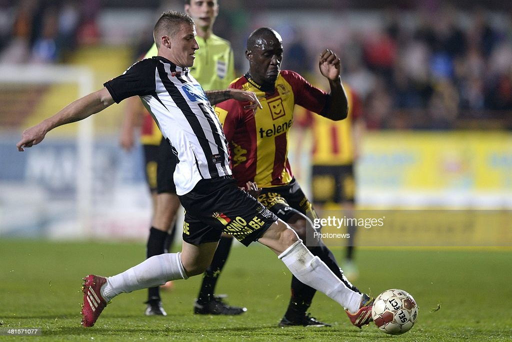 Benjamin Mokulu of KV Mechelen battles for the ball with Sebastien Dewaest of Charleroi during the Jupiler Pro League play off 2 match between KV...