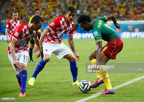 Benjamin Moukandjo of Cameroon controls the ball against Darijo Srna and Dejan Lovren of Croatia during the 2014 FIFA World Cup Brazil Group A match...