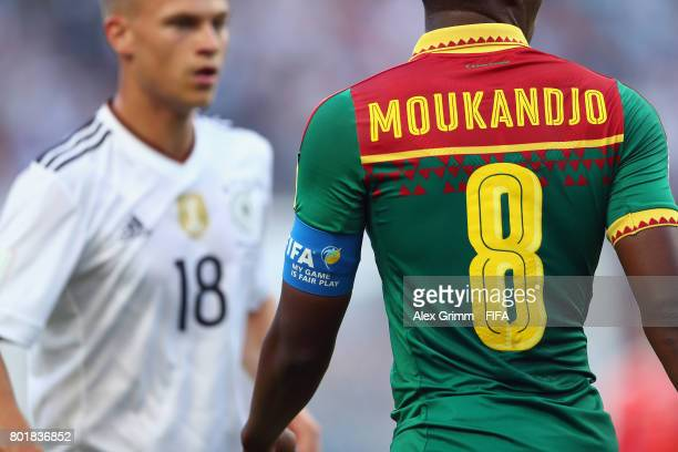 Benjamin Moukandjo of Cameroon walks past Joshua Kimmich of Germany during the FIFA Confederations Cup Russia 2017 Group B match between Germany and...