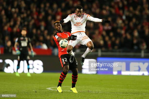 Benjamin Moukandjo of Lorient and Joris Gnagnon of Rennes during the French Ligue 1 match between Rennes and Lorient at Roazhon Park on February 25...