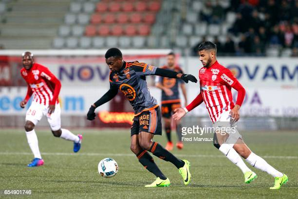 Benjamin Moukandjo of Lorient and Youssef Ait Bennasser of Nancy during the French League match between Nancy and Lorient at Stade Marcel Picot on...