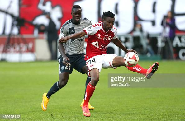 Benjamin Moukandjo of Stade de Reims and Benjamin Mendy of OM in action during the French Ligue 1 match between Stade de Reims and Olympique de...