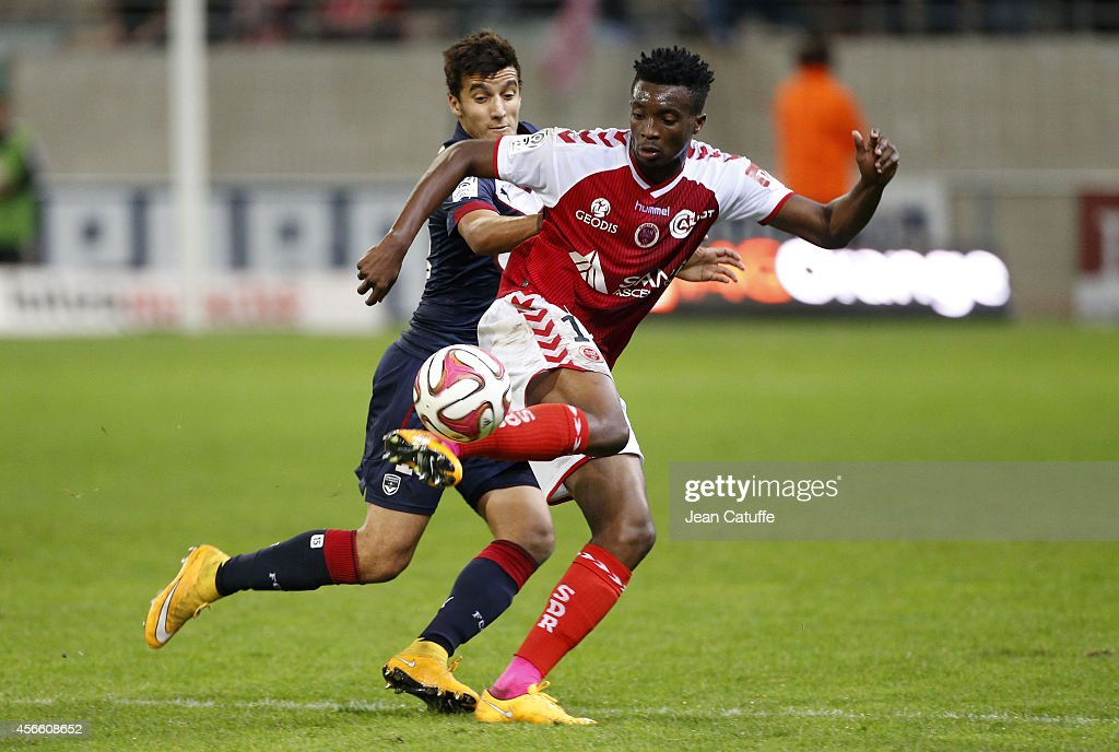 <a gi-track='captionPersonalityLinkClicked' href=/galleries/search?phrase=Benjamin+Moukandjo&family=editorial&specificpeople=7470600 ng-click='$event.stopPropagation()'>Benjamin Moukandjo</a> of Stade de Reims and Younes Kaabouni of Bordeaux in action during the French Ligue 1 match between Stade de Reims and FC Girondins de Bordeaux at the Stade Auguste Delaune on October 3, 2014 in Reims, France.