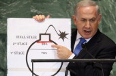 Benjamin Netanyahu Prime Minister of Israel points to a red line he drew on a graphic of a bomb while addressing the United Nations General Assembly...