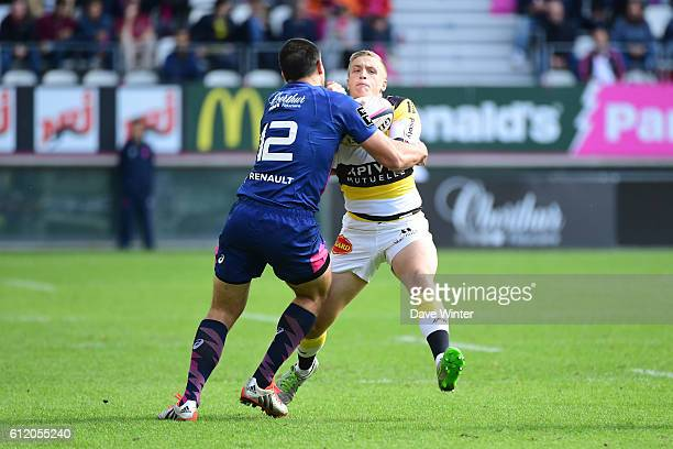 Benjamin Noble of La Rochelle takes on Theo Millet of Stade Francais Paris during the Top 14 match between Stade Francais and Stade Rochelais on...