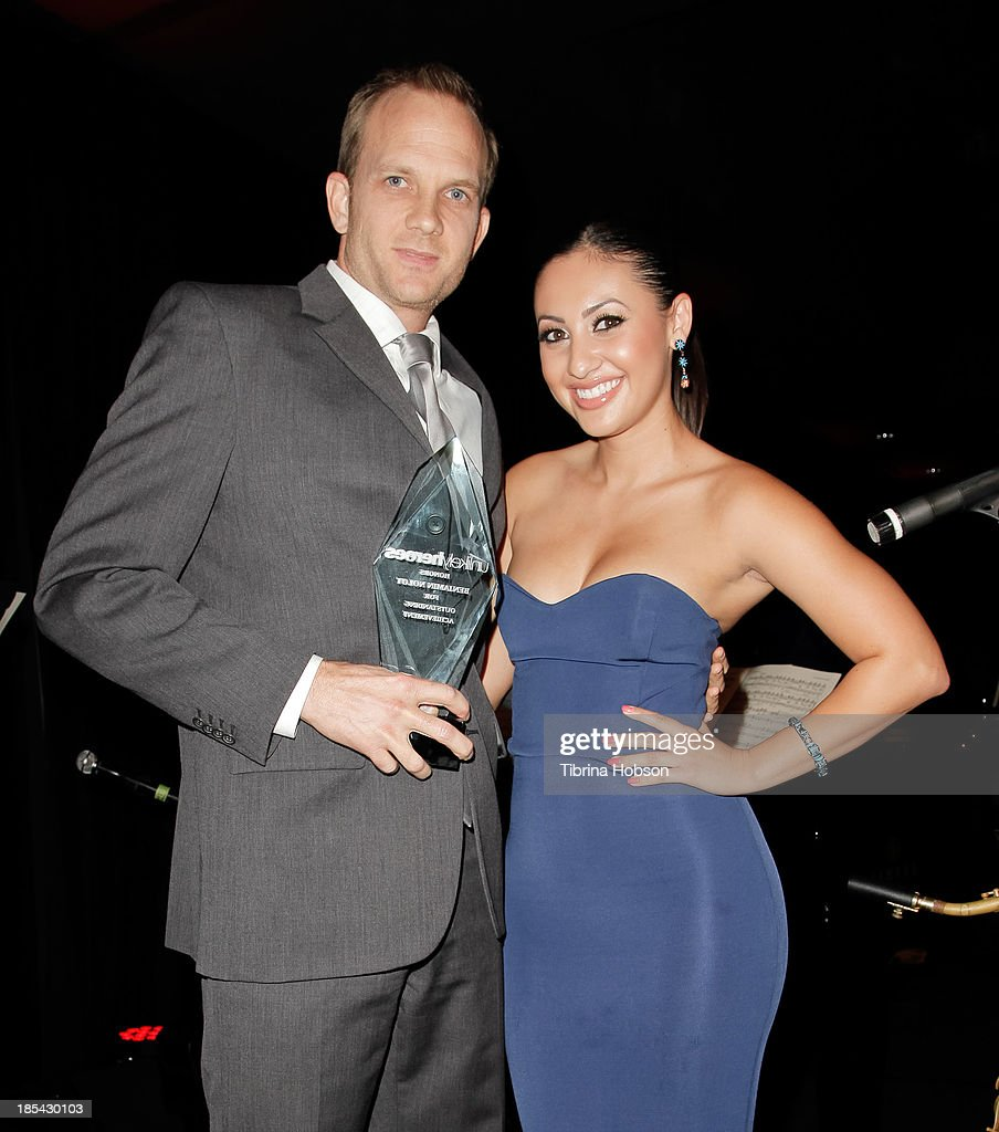 Benjamin Nolot and Francia Raisa attend at the Unlikely Heroes' recognizing heroes awards dinner And gala at W Hollywood on October 19, 2013 in Hollywood, California.