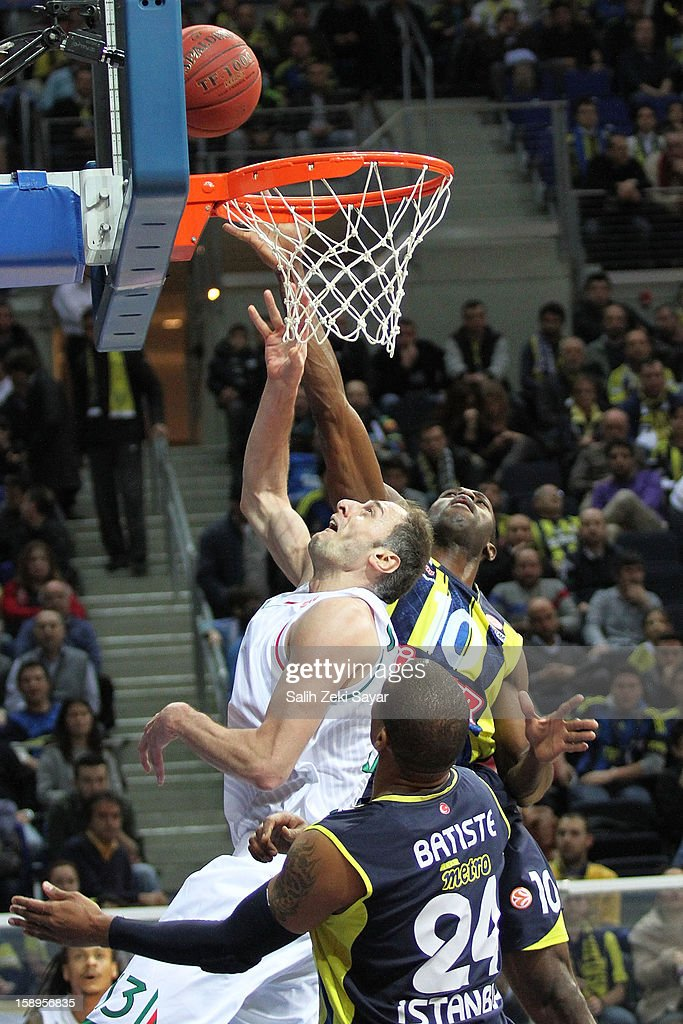 Benjamin Ortner #16 of Montepaschi Siena competes with Romain Sato #10 of Fenerbahce Ulker during the 2012-2013 Turkish Airlines Euroleague Top 16 Date 2 between Fenerbahce Ulker Istanbul v Montepaschi Siena at Fenerbahce Ulker Sports Arena on January 4, 2013 in Istanbul, Turkey.