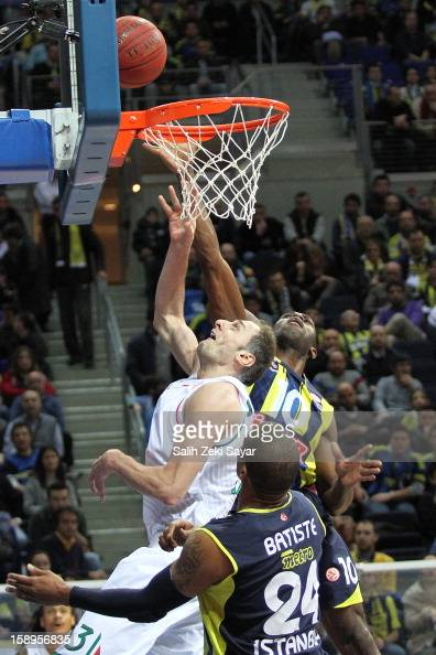 Benjamin Ortner of Montepaschi Siena competes with Romain Sato of Fenerbahce Ulker during the 20122013 Turkish Airlines Euroleague Top 16 Date 2...