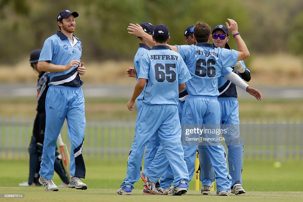 Benjamin Patterson (66) of New South Wales celebrates with team mates taking the wicket of Nathan Gardiner of Victoria on day 1 of the National Indigenous Cricket Championships on February 8, 2016 in Alice Springs, Australia.