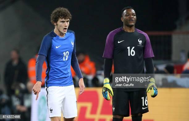 Benjamin Pavard of France goalkeeper of France Steve Mandanda during the international friendly match between Germany and France at...
